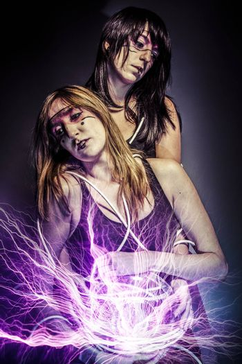 two women of the future, Twin, future concept, light rays