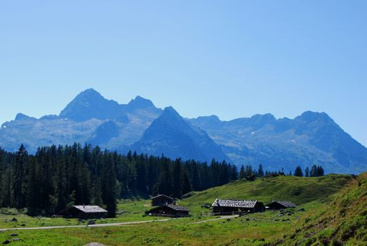 many wooden houses and high mountains