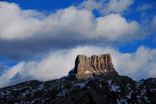 huge single rock in the mountains with blue sky