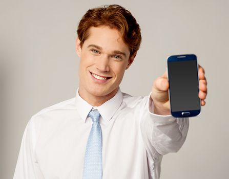 Salesman displaying newly launched mobile