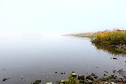 Lake with smog at morning