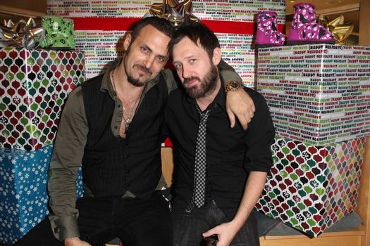 Spiros Poros and Mick at the launch of Kylie Bax and Spiros Poros' Moro Moro Kids Boot Collection at Ron Robinson Lifesize, Fred Segal, Santa Monica, CA. 12-11-10/ImageCollect