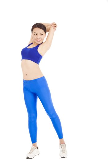 smiling Asian woman stretching her arm and smiling