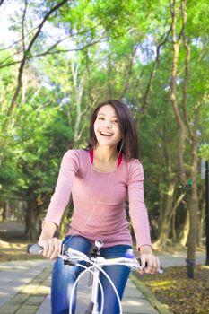 Pretty girl riding a bike and enjoy free time