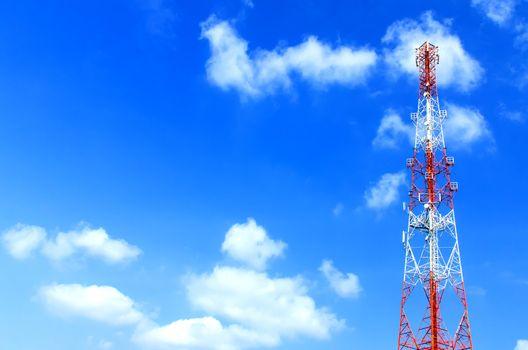 communication antennas, radio telephone mobile phone antennas on blue sky