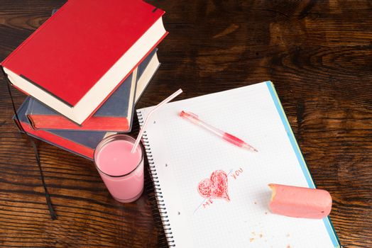 College romance,  heart shaped scribbling in a notebook