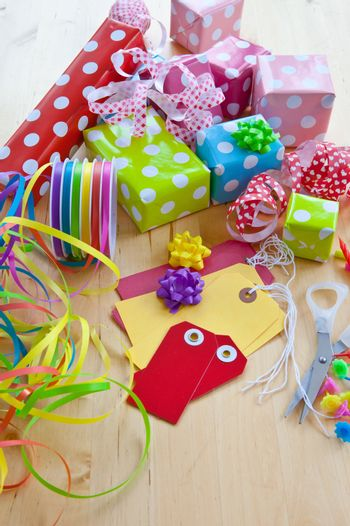 Colorful gift boxes wrapped in dotted paper