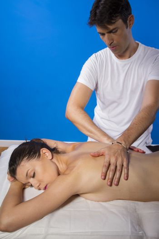 Pleasure.Masseur doing massage on woman body in the spa salon. Beauty treatment concept.