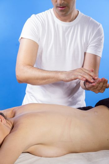 Skin care.Masseur doing massage on woman body in the spa salon. Beauty treatment concept.