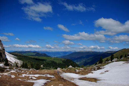 many mountains and blue sky on a mountain bike tour