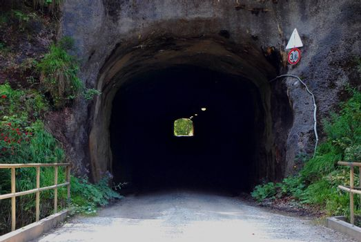 dark tunnel in a mountain on a road
