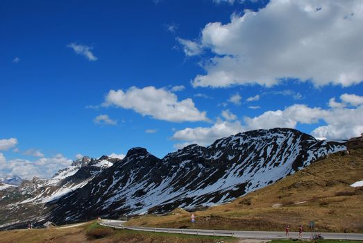 road in a beautiful mountains landscape with sky