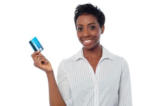 Woman displaying her debit card