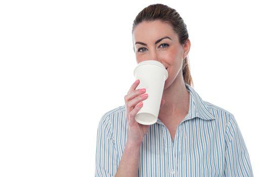Female employer enjoying beverage
