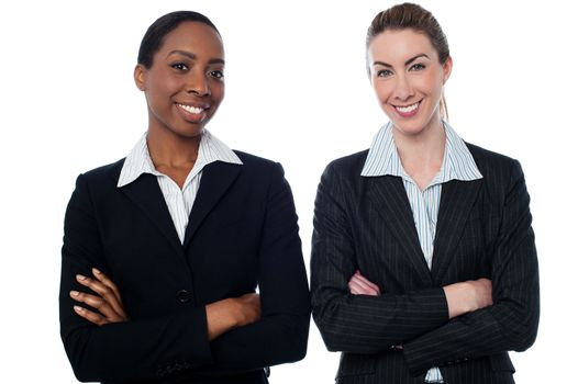 Happy businesswomen with arms crossed