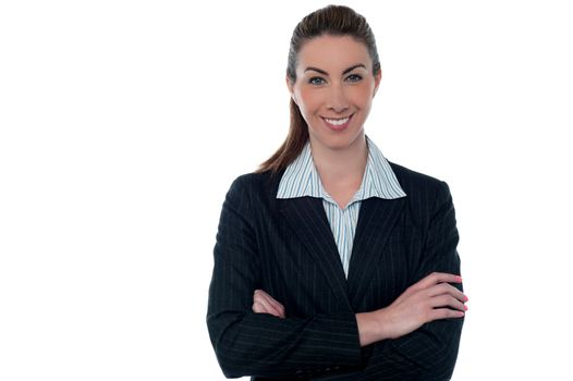 Smiling professional lady posing with arms crossed