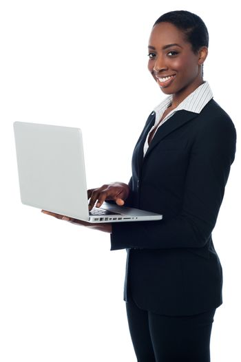 Corporate lady working on laptop