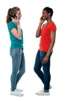 Trendy females speaking over cellphone