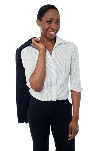 Executive with coat slung over her shoulder