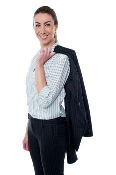 Businesswoman with coat slung over her shoulder