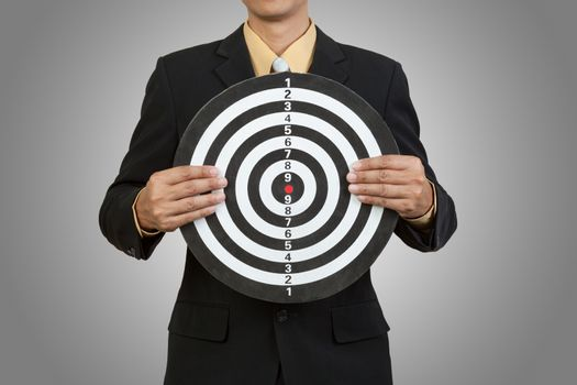 Businessman hold the target