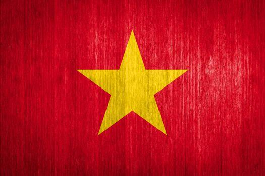 Vietnam Flag on wood background