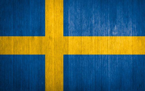 Sweden Flag on wood background