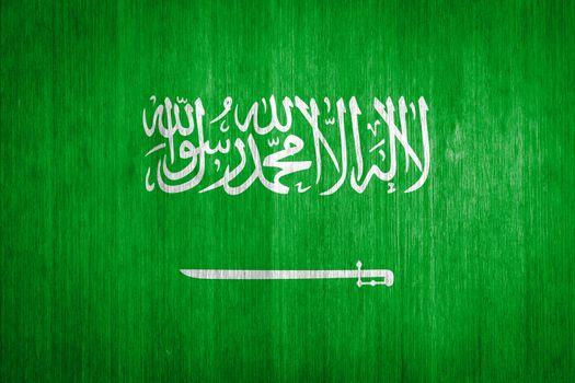Saudi Arabia Flag on wood background