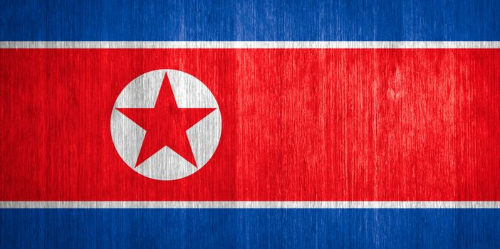 North Korea Flag on wood background