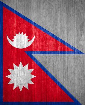 Nepal Flag on wood background