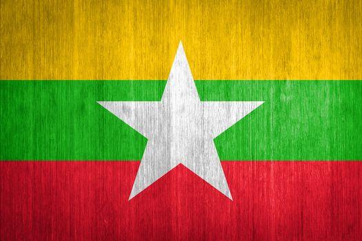 Myanmar Flag on wood background