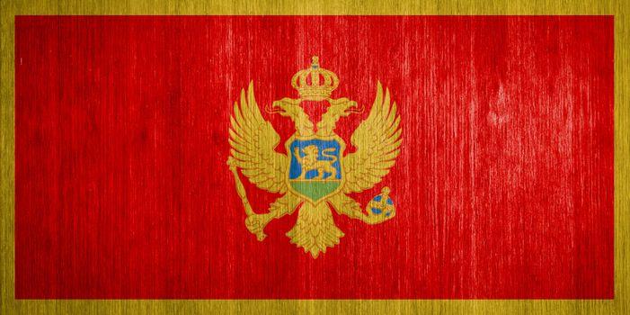 Montenegro Flag on wood background