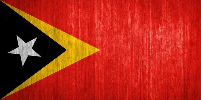 East Timor Flag on wood background