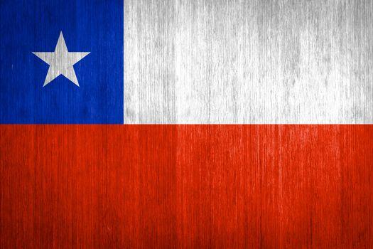 Chile Flag on wood background