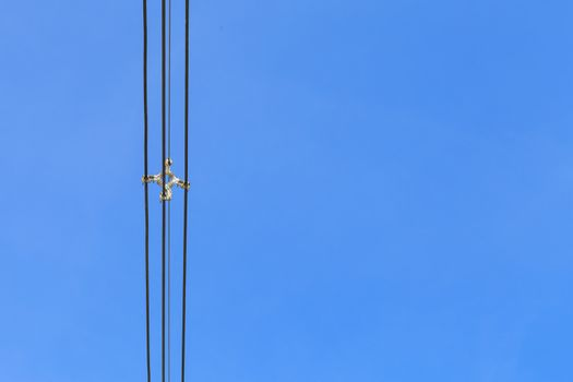 Electricity cable over blue sky