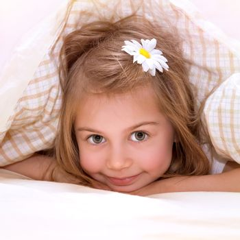 Little girl in the bed