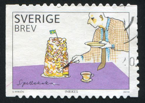 SWEDEN - CIRCA 2010: stamp printed by Sweden, shows Man and Birthday Cake, circa 2010
