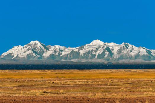 Bolivian mountains from peruvian Andes Titicaca Lake Puno Peru