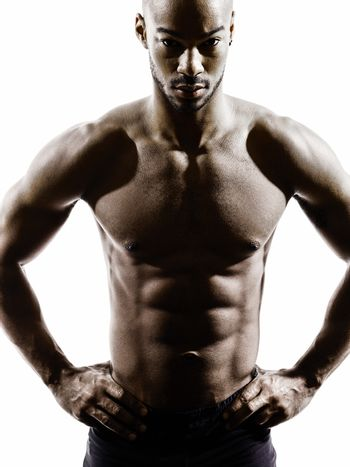 young african muscular build man topless silhouette