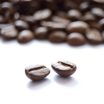 Big Heap of Brown Coffee Beans Isolated on White Background