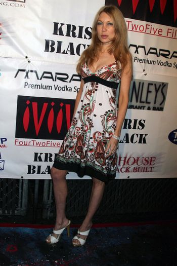 Mycole Metcalf at the Opening of 'The Abstract Art of Kris Black' benefitting Survivors of Sexual Abuse. Stanley's Restaurant and Bar, Sherman Oaks, CA. 05-21-09/ImageCollect