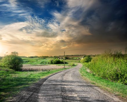 Country road in the countryside at sunset