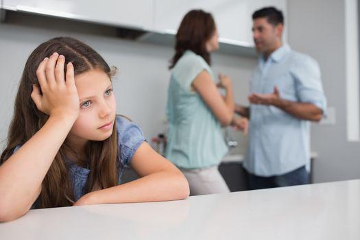 Closeup of a sad girl while parents quarreling