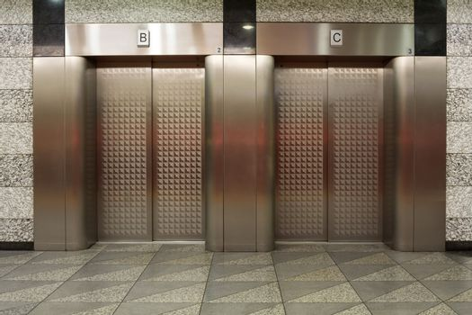 Two elevators with metal doors - For photography location background