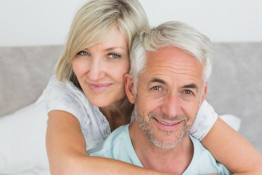 Closeup portrait of a loving mature couple in bed at home