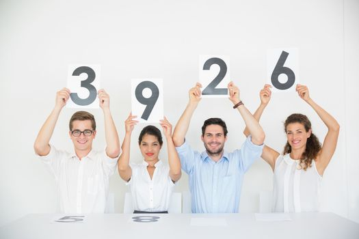 Panel judges holding score signs