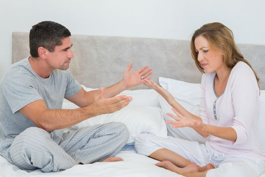 Frustrated couple in bedroom