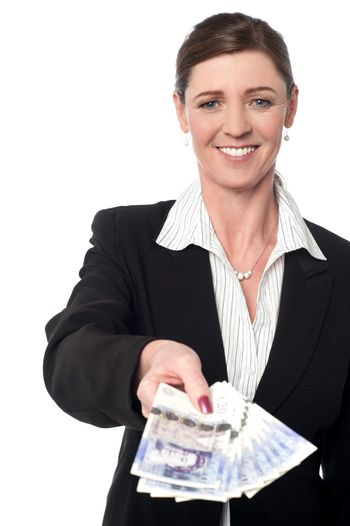 Smiling corporate woman showing british pound