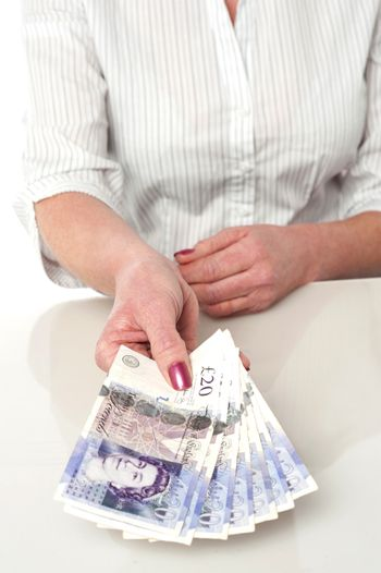 Woman is paying in british currency