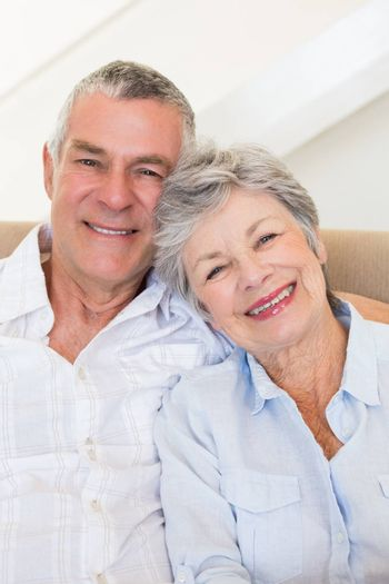 Portrait of affectionate senior couple smiling together at home